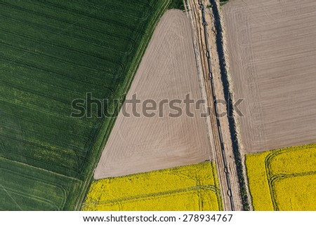 aerial view of burying gas pipe in a country harvest fields  area  in Poland