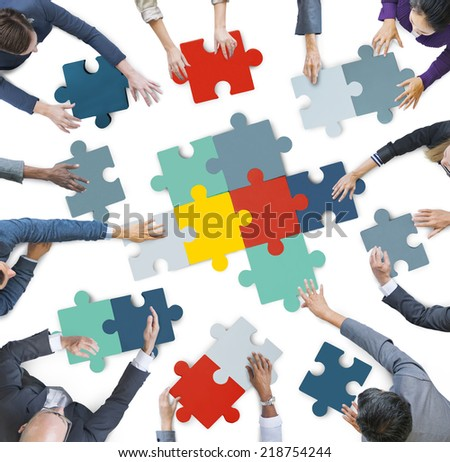 Aerial View of Business People Piecing Puzzle Pieces - stock photo
