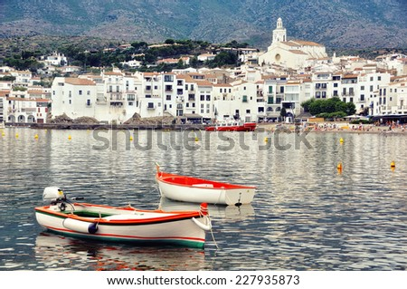 Aerial view of Cadaques, Spain with Cathedral, sea and Two Boats