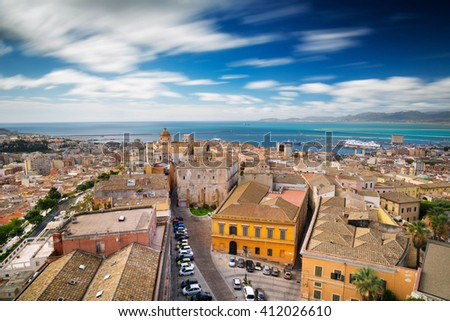 Aerial view of Cagliari, capital of Sardinia - Long exposure to move the clouds in the sky - stock photo