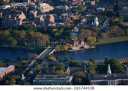 AERIAL VIEW of Cambridge and Anderson Memorial Bridge leading to Weld Boathouse, Harvard on Charles River, Cambridge, Boston, MA  - stock photo