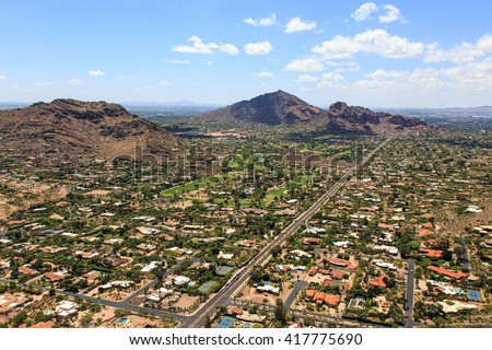 Aerial view of Camelback and Mummy Mountains from Paradise Valley, Arizona - stock photo