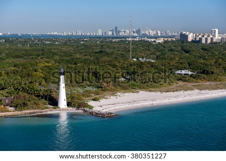 aerial view of Cape Florida lighthouse with Miami skyline in the background on clear sunny morning