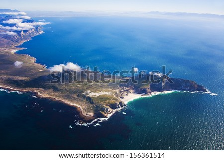 Aerial view of Cape Point with Table Mountain in the distance, Cape Town, South Africa - stock photo