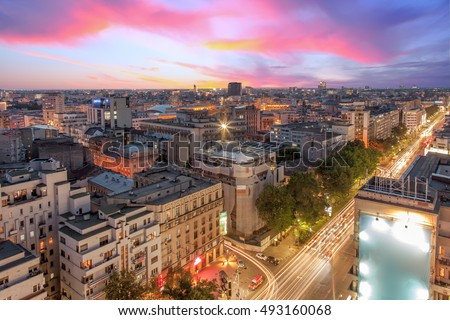 Aerial view of capital city Bucharest, Romania. Dramatic sunset with traffic lights.