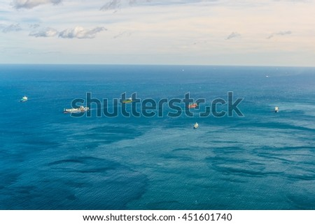 aerial view of cargo ships cruising over mediterranean sea near gibraltar