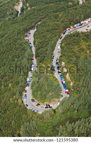 aerial view of cars are going through a mountain road - stock photo