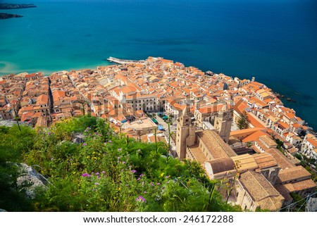 aerial view of Cefalu Duomo Cathedral and orange roofs of old houses, Sicily - stock photo