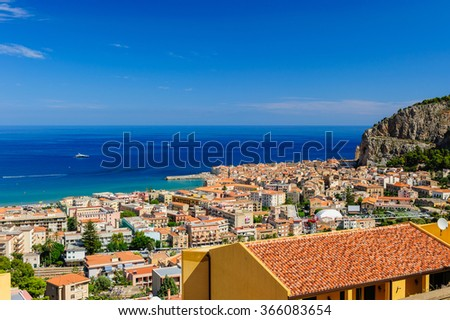 Aerial view of Cefalu with the blue sea and skies, Sicily, Italy. - stock photo