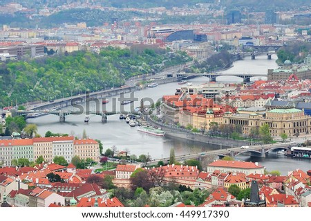 Aerial view of Charles Bridge over Vltava river and Old city from Petrin hill Observation Tower. Prague, Czech Republic