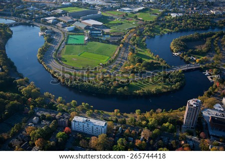 AERIAL VIEW of Charles River with view of Harvard's Soldier Field, Cambridge, Boston, MA  - stock photo