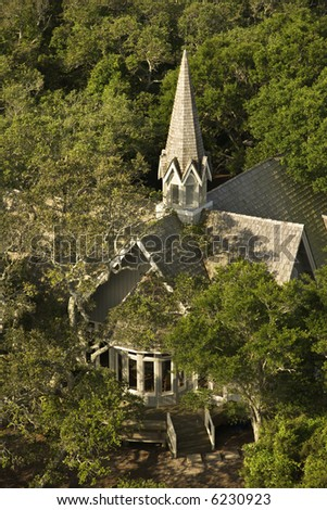 Aerial view of church surrounded by trees on Bald Head Island, North Carolina. - stock photo