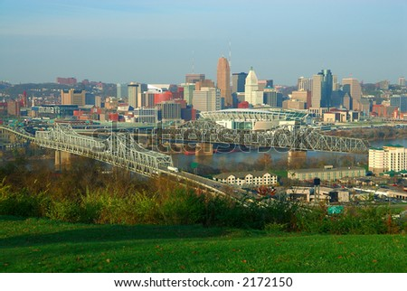 Aerial view of Cincinnati OH and the Ohio River from the hills of Devoe Park in Kentucky, USA. Brent Spence Bridge on the left, Railroad Bridge on the right, Paul Brown Stadium across the river.