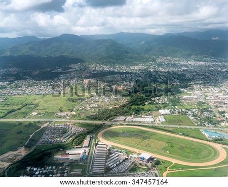 Aerial view of cityscape against cloudy sky, Trinidad, Trinidad and Tobago