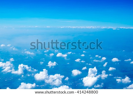 Aerial view of cloud and sky from airplane,Traveling concept. - stock photo