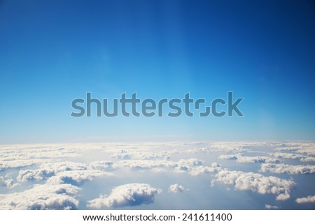 aerial view of clouds and blue sky from airplane