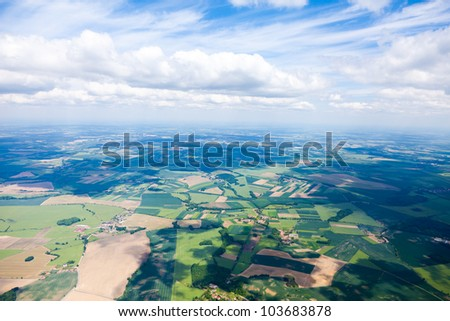 aerial view of clouds and village landscape