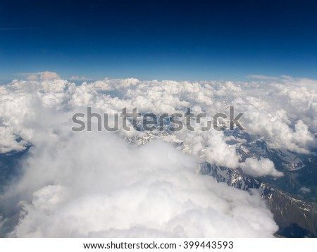 Aerial view of clouds over Alps mountains
