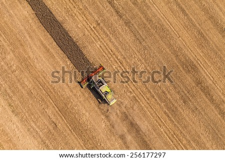 aerial view of combine on harvest field  in Poland