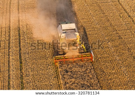 aerial view of combine on harvest field in Poland - stock photo
