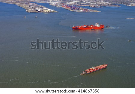 Aerial view of Container Ship and Bayonne Dry Dock and Repair. Global container terminal on the right. In Bayonne, New Jersey, USA