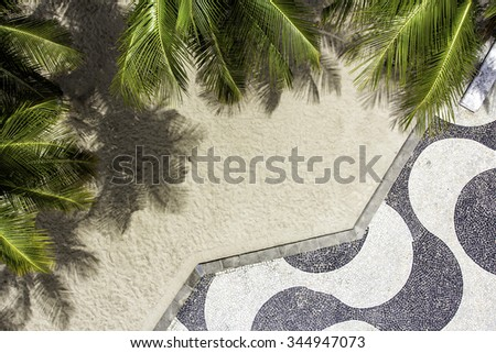 Aerial view of Copacabana Beach sidewalk mosaic with palms. Top view