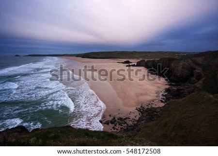 Aerial view of deserted beach in Perranporth (Cornwall, England) at dusk.