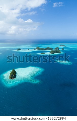 Aerial view of deserted tropical islands, coral reef and clear blue water, Palau, Micronesia - stock photo