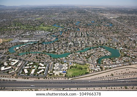 Aerial view of Dobson Ranch housing development in Mesa, Arizona looking South from the US 60 Superstition Freeway - stock photo