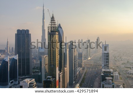 Aerial view of Downtown Dubai with Dubai Fountain and skyscrapers from the tallest building in the world, Burj Khalifa, Sheikh Zayed Road - stock photo