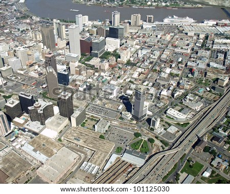 aerial view of downtown New Orleans with the he Mississippi River Cruise ship port the in the background; New Orleans Louisiana USA - stock photo
