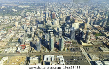 Aerial view of Downtown San Diego, Southern California, United States of America. A view of the skyline, waterfront skyscrapers, tall towers and buildings in the city center. - stock photo
