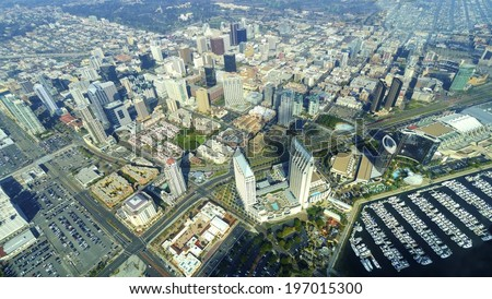 Aerial view of Downtown San Diego, Southern California, United States of America. A view of the skyline, waterfront skyscrapers, the Marina, tall towers and buildings in the city center. - stock photo