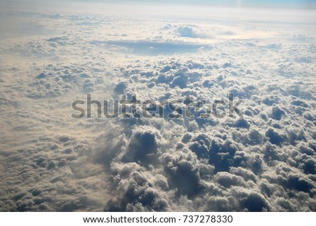 aerial view of dramatic sky and cloud from airplane