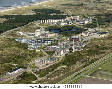 Aerial view of ECN PETTEN, a nuclear research station in the dunes of Holland with the Northsea in the background.