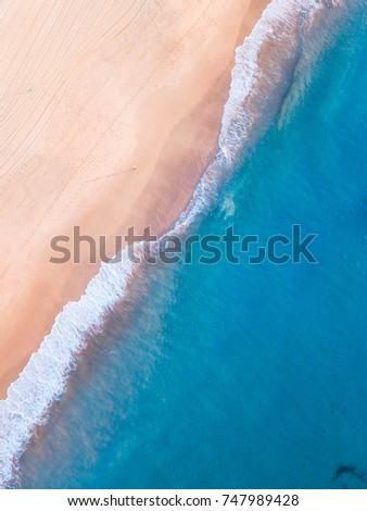 Aerial view of empty beach in the morning.
