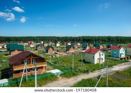 Aerial view of family homes in suburban neighborhood. the construction of low-rise housing - stock photo