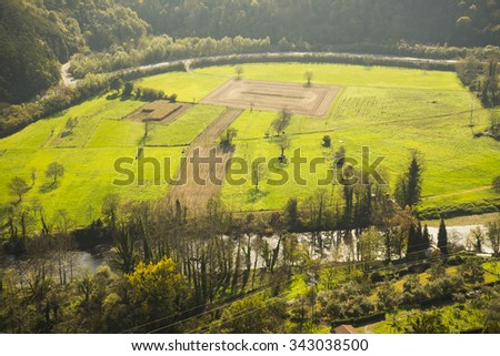 Aerial view of fertile farmlands - stock photo