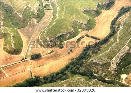 Aerial view of fields and rocks - stock photo