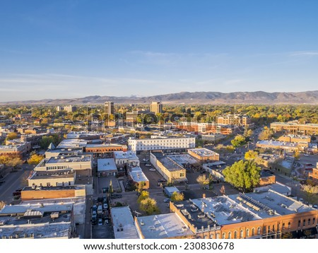 aerial view of Fort Collins downtown in sunrise light, shot from a low flying drone - stock photo