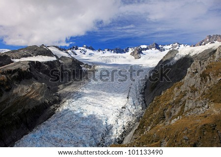Aerial view of Fox glacier from helicopter, Westland Tai Poutini National Park on the West Coast of New Zealand - stock photo
