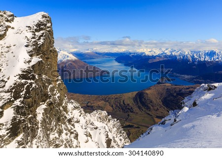 aerial view of Frankton and Lake Wakatipu from the Remarkables Mountain,  Queenstown, New Zealand - stock photo