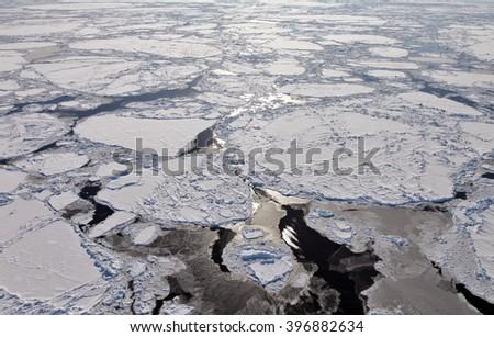 Aerial view of frozen Arctic Ocean  - stock photo