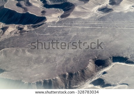 Aerial view of geoglyphs near Nazca - famous Nazca Lines, Peru. In the center, Hummingbird figure is present. - stock photo