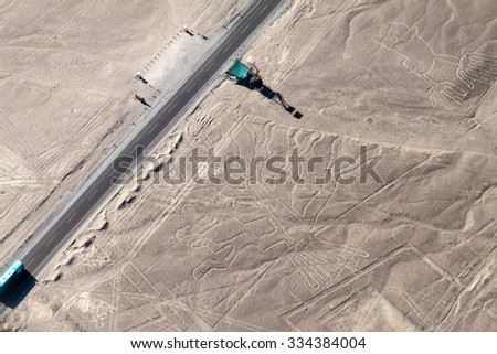 Aerial view of geoglyphs near Nazca - Nazca Lines, Peru. In the center, Tree figure is present, on the right side, Hands figure as well. Observation tower and Panamericana highway on the left side. - stock photo