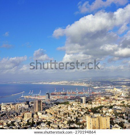 Aerial view of Haifa city, ships were at anchor in the waters of the port of Haifa, Israel, Mediterranean sea - stock photo
