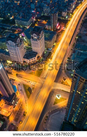 Aerial view of Hanoi cityscape at twilight period with skyscraper and intersection Pham Hung - Duong Dinh Nghe, Tu Liem district, Hanoi, Vietnam. Modern Hanoi city.