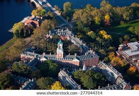 AERIAL VIEW of Harvard Campus featuring Eliot House Clock Tower along Charles River, Cambridge, Boston, MA  - stock photo