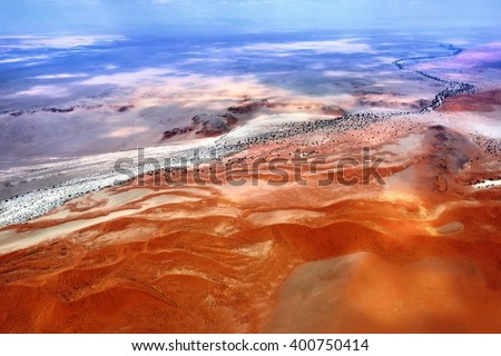 Aerial view of high red dunes, located in the Namib Desert, in  Namibia, Africa at sunset light