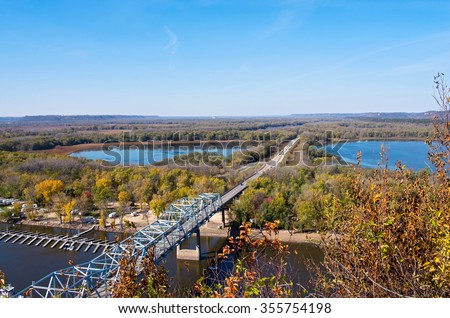 aerial view of highway 63 bridge crossing mississippi river and backwaters into wisconsin from barn bluff in red wing minnesota - stock photo